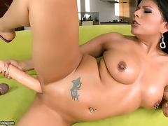 Nasty Yoha stuffs her pussy with extremely big dildos