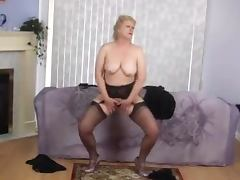Kinky blonde granny dances striptease in front of a cam