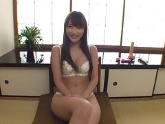 Japanese hottie Rina Yada enjoys playing with a dildo in her room