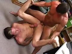 Two muscular gays enjoy some naughty banging in an office