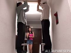Sarina Takeuchi gives a blowjob to two guys in a corridor