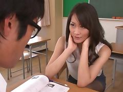 Beautiful Miku Aoki gives hot blowjob in a classroom