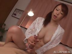 Riri Ouka gives a handjob and a footjob to some lucky man