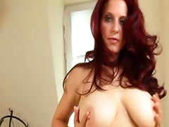 Redhead milf Bettie Ballhaus is poking her shaved pussy