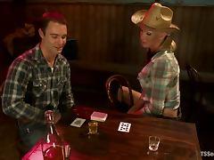 Hot blonde tranny in cowboy hat fucks a guy in a bar
