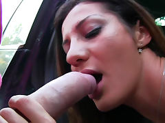 Brunette is fucking in her shaved pussy in the taxi