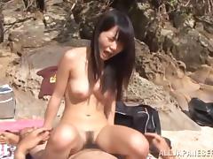 An amateur Asian couple go to the beach for sex