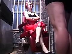 Femdom secures male in leather thraldom restraints