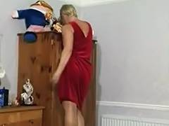 Blonde mature sweetie stripping and masturbating