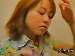 A redhead Japanese girl is masturbating her pussy