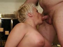 Blonde granny takes multiple cocks deep