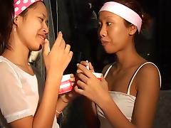Saori and Saya Thai nubiles take up with the tongue ice-sex cream titty thaigirltia.com