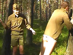 Sexy soldiers are spanking each other in the forest