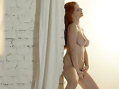 Unbeliveably busty redhead stripping