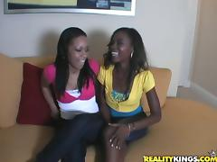 Two black bitches lick each other's tits and share a cock