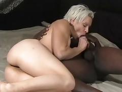 Blonde with small tits sucks black cock