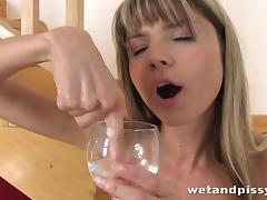 cute blonde plays with her piss porn video