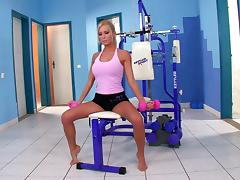 Sporty blonde Maddy entertains herself by fingering her shaved vag