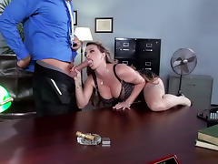 Busty secretary gets rammed in the office