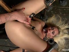 Wet blonde girl gets chained and fisted in a wooden cabin