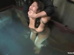 Juicy Asian honey is being bondaged in the tank