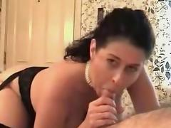 Busty wife sucks on a stiff boner