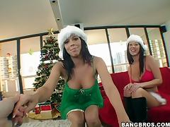 Two slutty brunettes fuck in FFM video neat a XMas tree