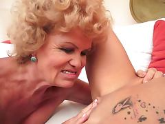 Curly-haired mature kisses sexy young blonde porn video