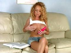 Curly-haired blonde toys her pussy before taking a ride on a schlong