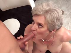 Hardcore granny is sucking a big dick