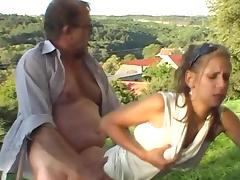 Sexy couple is having sex on the grass