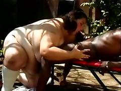 Brunette BBW Whore Sucking A Big Black Cock In The Backyard