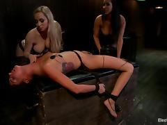 Slim brunette girl gets wired and toyed by two mistresses porn video