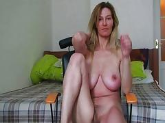 MILF with broad in the beam boobs rubs her mature pussy