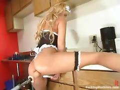 Horny blonde bachelor girl gets toyed in a kitchen wits fucking machine