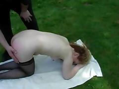Long-haired skank Claire gets her ass spanked hard in the garden
