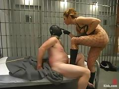 Hot mistress in police uniform dominates a guy in a prison porn video