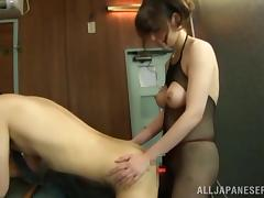 Japanese milf rubs her man's dick and fucks his butt with a strapon