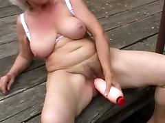 Nasty granny Stella enjoys toying her old hairy cunt outdoors