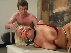Blonde Xana Star gets her big boobs tortured in a basement