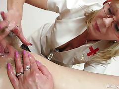 lesbian nurse lubes and fucks a hairy cunt