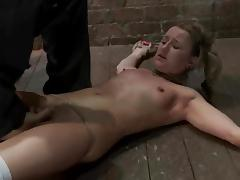 Bondage video with slim blonde in stockings getting toyed