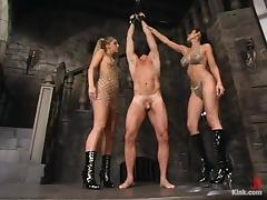 A guy gets tortured and fucked by two sexy bitches in a basement