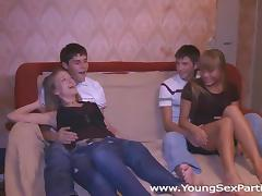 Swinger sex warming up teens' cocks and pussies