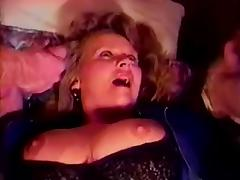 Mature slut has sex with two men in retro video