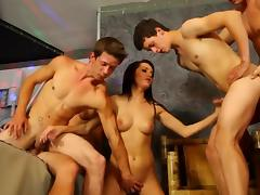 Sexy slut in group sucking cock