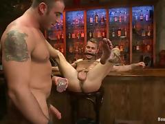 Tied up Spencer gets toyed and fucked by Zach in a bar