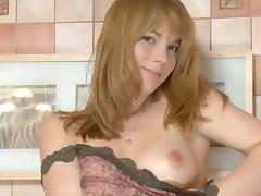 Smiling young Suzie is masturbating her shaved puss