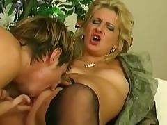 MILF blonde is masturbating while sucking a cock