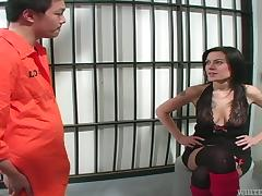 Sexy brunette chick gives a handjob to an inmate